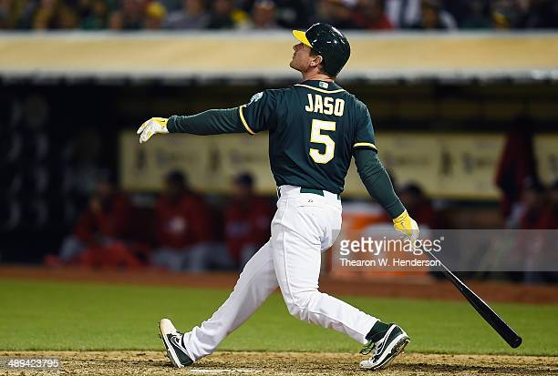 John Jaso of the Oakland Athletics hits a walkoff RBI double scoring Nick Punto to defeat the Washington Nationals in the Bottom of the tenth inning...