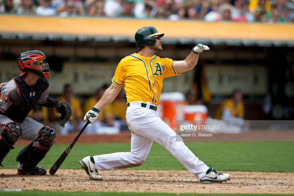 John Jaso #5 of the Oakland Athletics hits an RBI single against the Baltimore Orioles during the fourth inning at O.co Coliseum on July 20, 2014 in Oakland, California. The Oakland Athletics defeated the Baltimore Orioles 10-2.