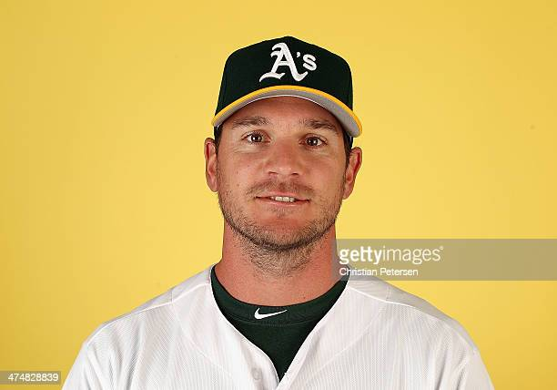 John Jaso of the Oakland Athletics poses for a portrait during the spring training photo day at Phoenix Municipal Stadium on February 22 2014 in...