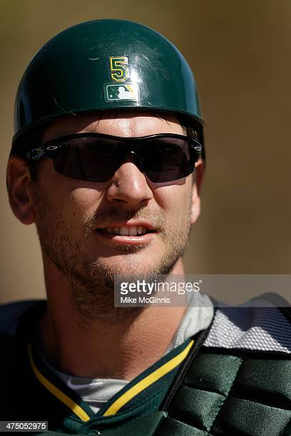 John Jaso of the Oakland Athletics stands in the dugout during a workout at Papago Baseball Facility on February 24 2014 in Phoenix Arizona