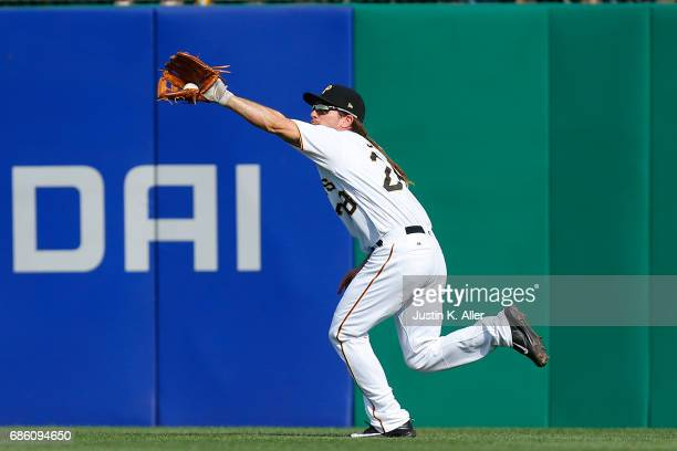 John Jaso of the Pittsburgh Pirates catches a line drive in the fifth inning against the Philadelphia Phillies at PNC Park on May 20 2017 in...