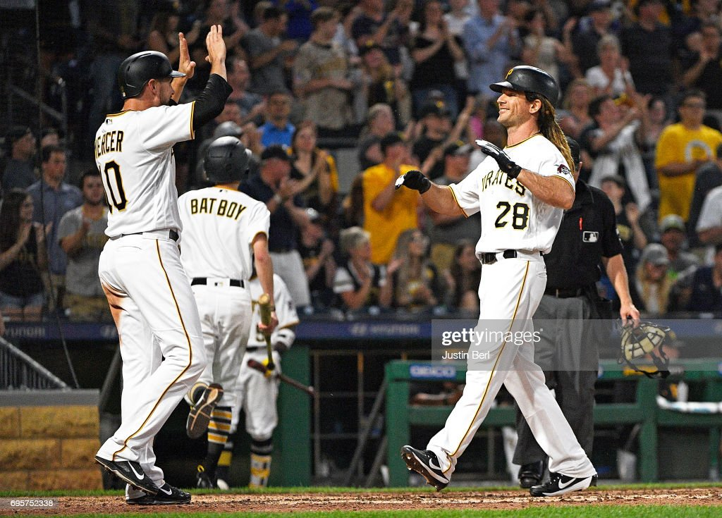 John Jaso #28 of the Pittsburgh Pirates celebrates with Jordy Mercer #10 after hitting a two run home run in the seventh inning during the game against the Colorado Rockies at PNC Park on June 13, 2017 in Pittsburgh, Pennsylvania.