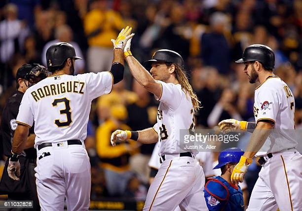 John Jaso of the Pittsburgh Pirates celebrates with Sean Rodriguez and Matt Joyce after hitting a three run home run in the fourth inning during the...