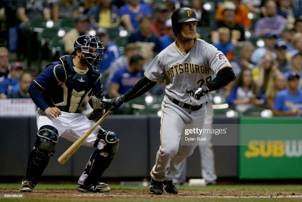 John Jaso #28 of the Pittsburgh Pirates hits a double in the fifth inning against the Milwaukee Brewers at Miller Park on June 21, 2017 in Milwaukee, Wisconsin.