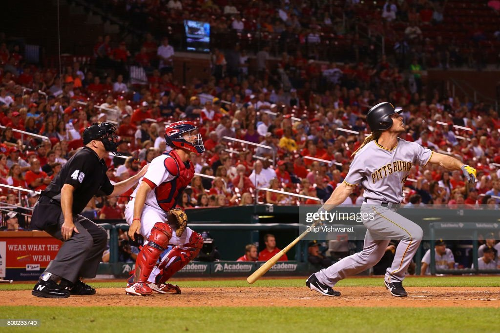 John Jaso #28 of the Pittsburgh Pirates hits a game-winning solo home run as umpire Ron Kulpa #46 and Eric Fryer #41 of the St. Louis Cardinals in the ninth inning at Busch Stadium on June 23, 2017 in St. Louis, Missouri.