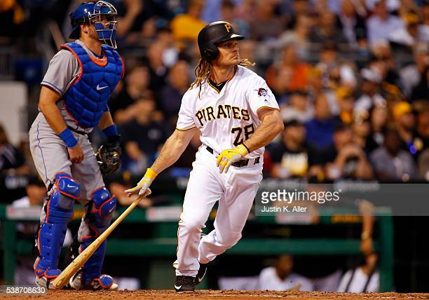 John Jaso of the Pittsburgh Pirates hits a RBI double in the fifth inning during the game against the New York Mets at PNC Park on June 7 2016 in...