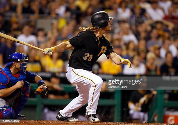 John Jaso of the Pittsburgh Pirates hits a RBI single in the seventh inning during the game against the Chicago Cubs at PNC Park on July 8 2016 in...