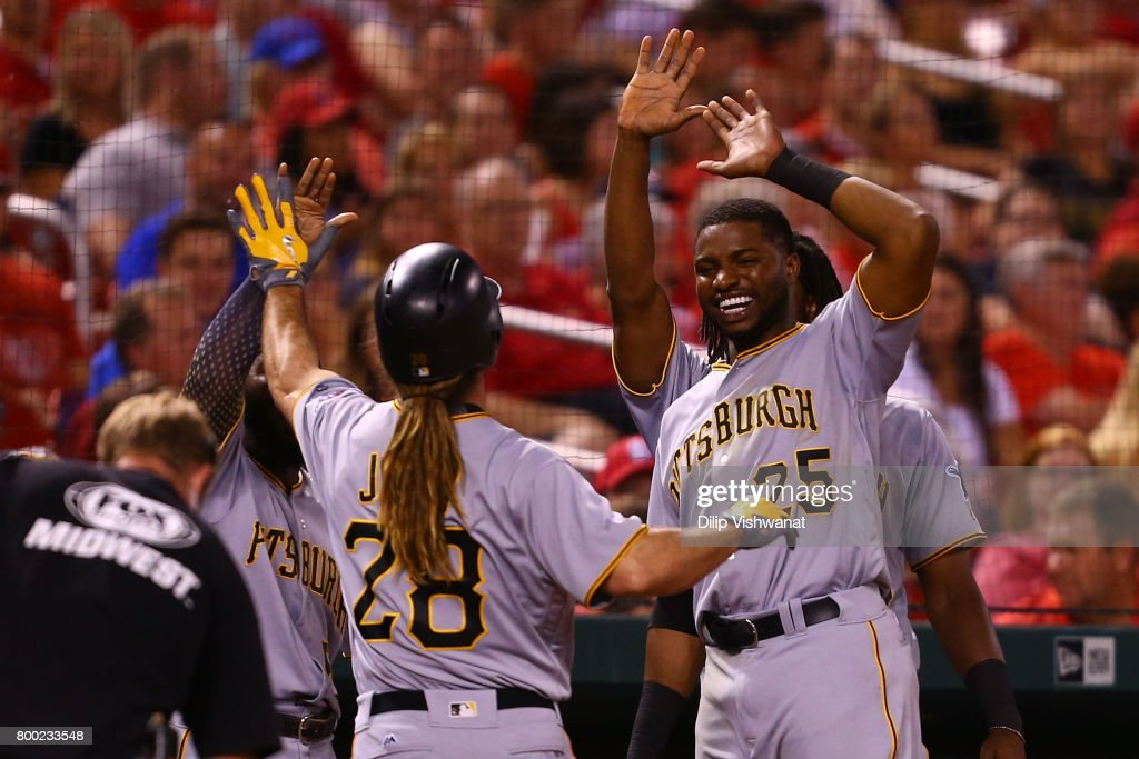 John Jaso #28 of the Pittsburgh Pirates is congratulated by Gregory Polanco #25 of the Pittsburgh Pirates after hitting a game-winning solo home run against the St. Louis Cardinals in the ninth inning at Busch Stadium on June 23, 2017 in St. Louis, Missouri.