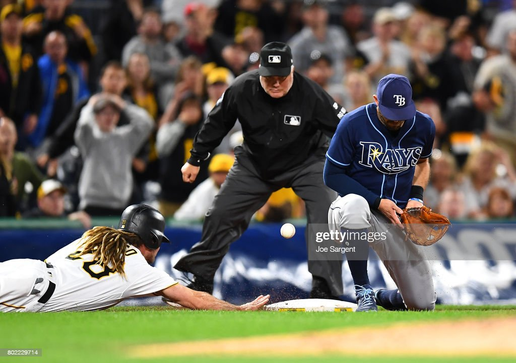 John Jaso #28 of the Pittsburgh Pirates slides safely into third base in front of Evan Longoria #3 of the Tampa Bay Rays during the ninth inning at PNC Park on June 27, 2017 in Pittsburgh, Pennsylvania.