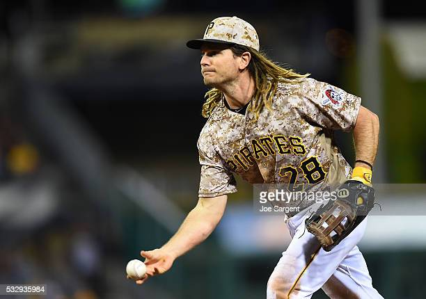 John Jaso of the Pittsburgh Pirates tosses the ball to first base during the eighth inning against the Atlanta Braves on May 19 2016 at PNC Park in...