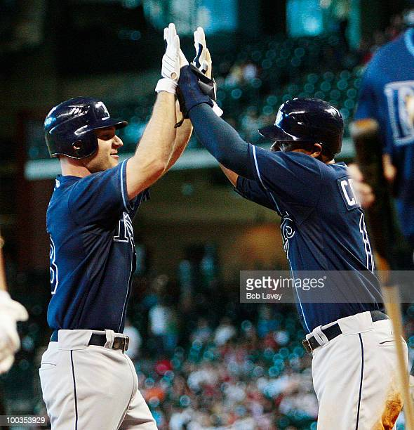 John Jaso of the Tampa Bay Rays gets high fives from Carl Crawford after hitting a two run home run in the fifth against the Houston Astros at Minute...