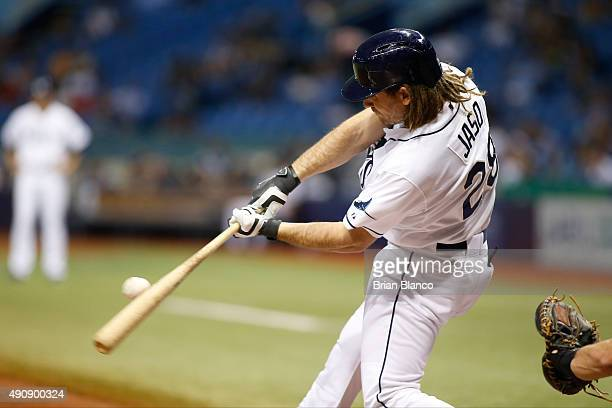 John Jaso of the Tampa Bay Rays hits a single to right field off of pitcher Jose Fernandez of the Miami Marlins during the third inning of a game on...