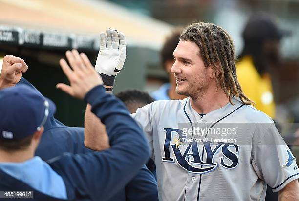 John Jaso of the Tampa Bay Rays is congratulated by teammates after Jaso hit a solo home run against the Oakland Athletics in the top of the second...