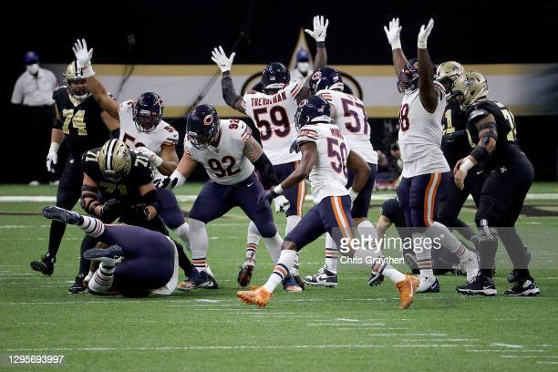 John Jenkins of the Chicago Bears catches an interception thrown by Taysom Hill of the New Orleans Saints during the second quarter in the NFC Wild...