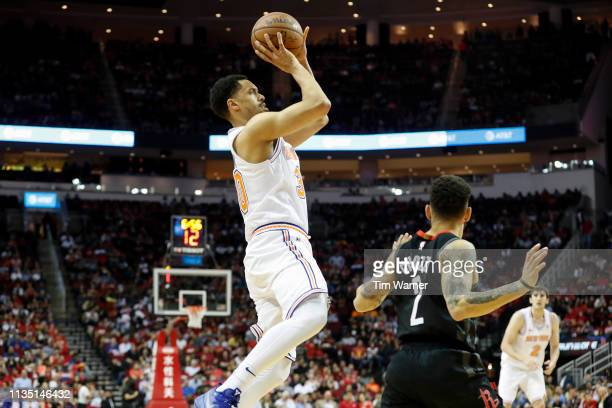 John Jenkins of the New York Knicks shoots the ball defended by Chris Chiozza of the Houston Rockets in the fourth quarter at Toyota Center on April...