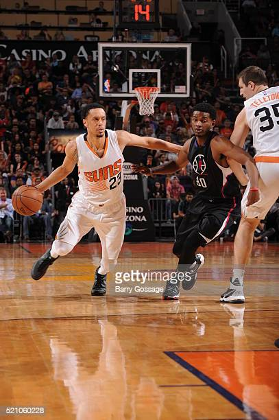 John Jenkins of the Phoenix Suns drives against CJ Wilcox of the Los Angeles Clippers on April 13 at Talking Stick Resort Arena in Phoenix Arizona...