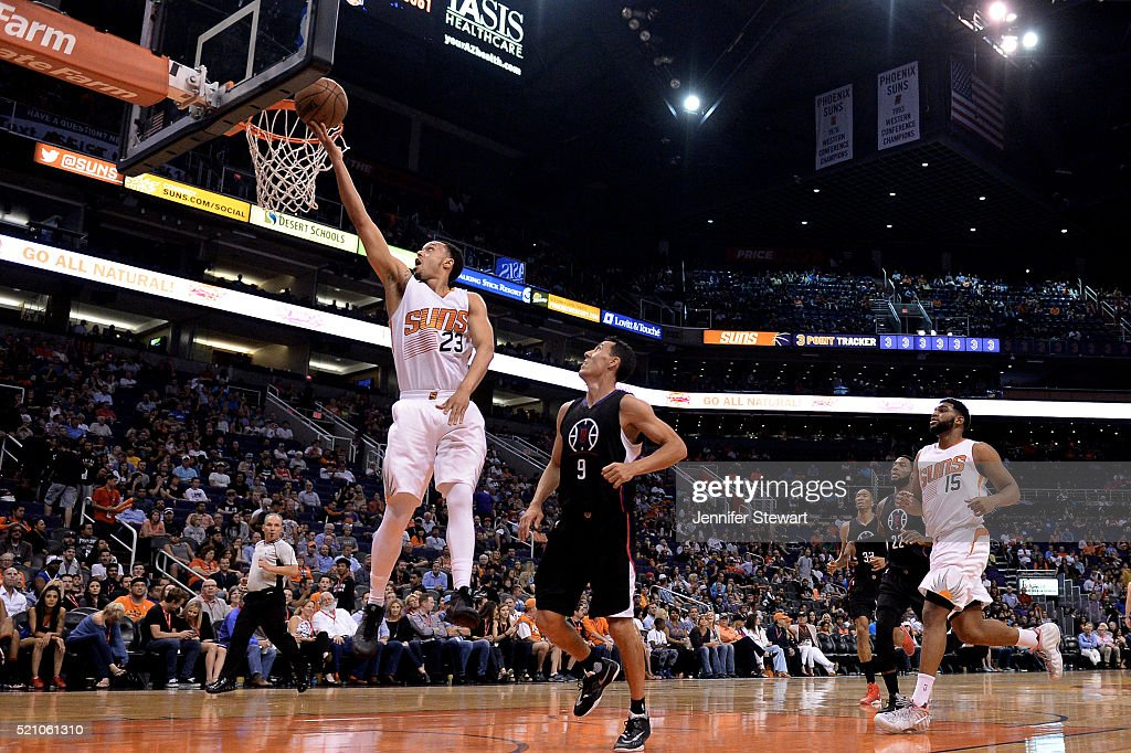 John Jenkins #23 of the Phoenix Suns lays up the ball in front of Pablo Prigioni #9 of the Los Angeles Clippers during the second half of the NBA game at Talking Stick Resort Arena on April 13, 2016 in Phoenix, Arizona. The Suns defeated the Clippers 114 - 105.