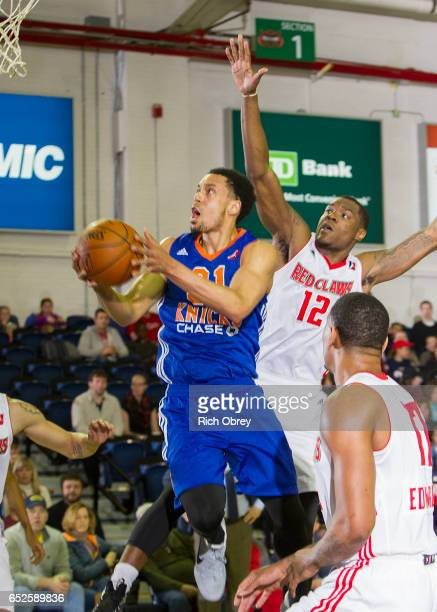 John Jenkins of the Westchester Knicks drives past Jalen Jones of the Maine Red Claws on Sunday March 12 2017 at the Portland Expo in Portland Maine...
