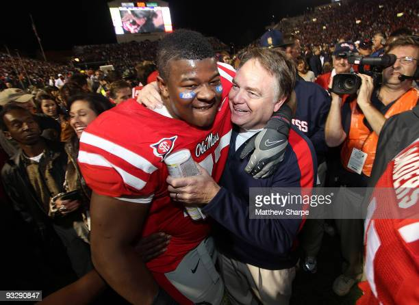 John Jerry and head coach Houston Nutt of the Ole Miss Rebels celebrate a victory over the LSU Tigers at Vaught-Hemingway Stadium on November 21,...