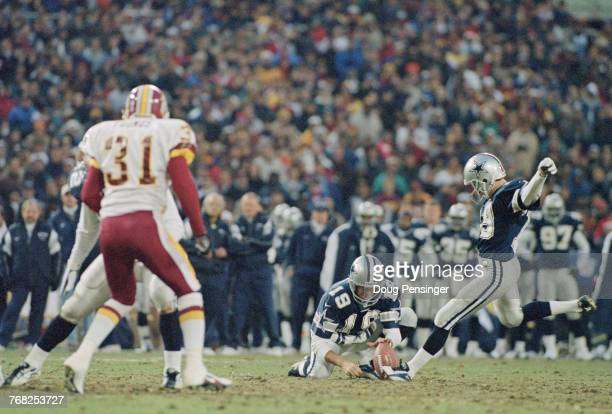 John Jett places the ball as Chris Boniol Kicker for the Dallas Cowboys kicks foe goal during the National Football Conference East game against the...