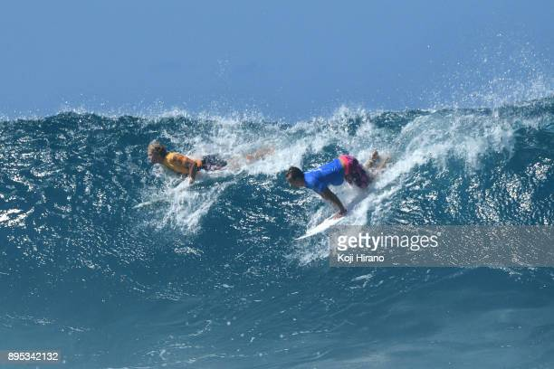 John John Florence and Julian Wilson compete in the 2017 Billabong Pipe Masters on December 18 2017 in Pupukea Hawaii