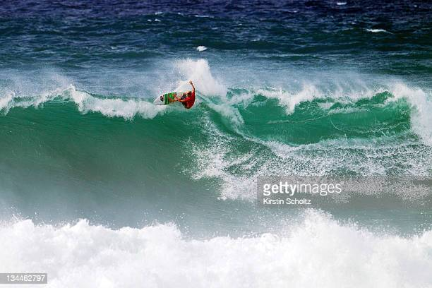 John John Florence of Hawaii surfs in huge wave during the round of 64 at the Vans World Cup of Surfing on December 1 2011 in Sunset Beach United...