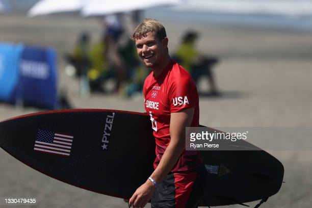 John John Florence of Team United States reacts after winning his Men's Round 2 heat on day two of the Tokyo 2020 Olympic Games at Tsurigasaki...