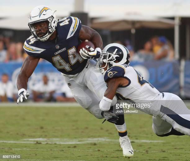 John Johnson III of the Los Angeles Rams tackles Andre Williams of the Los Angeles Chargers during the preseason game between the Los Angeles Rams...