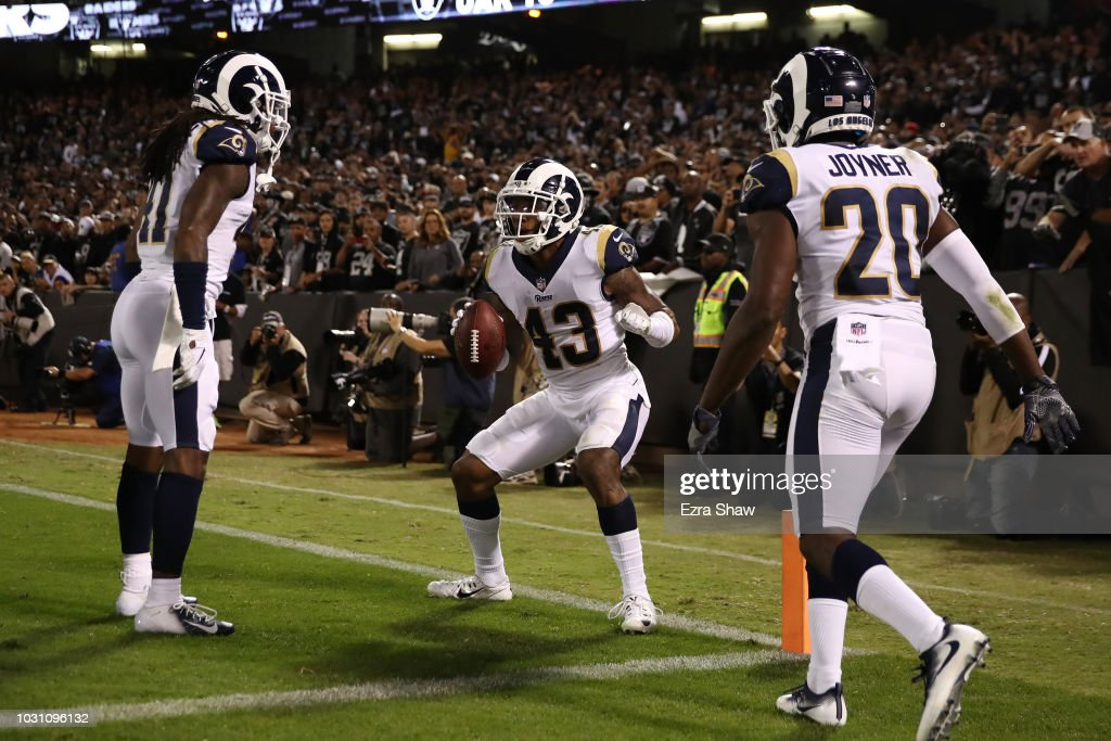 John Johnson #43 of the Los Angeles Rams celebrates after intercepting a pass intended for Jared Cook #87 of the Oakland Raiders in the endzone during their NFL game at Oakland-Alameda County Coliseum on September 10, 2018 in Oakland, California.