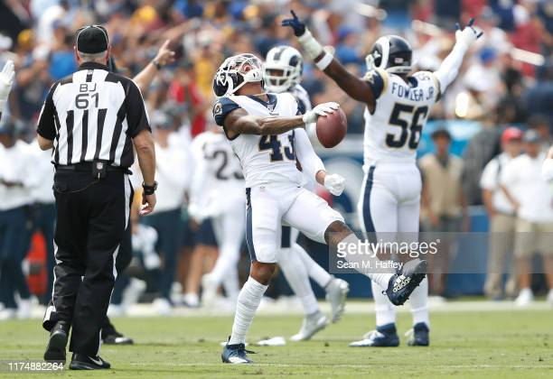 John Johnson of the Los Angeles Rams celebrates after intercepting a pass intended for Jared Cook of the New Orleans Saints during the first quarter...