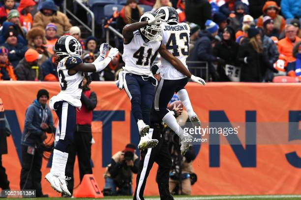 John Johnson of the Los Angeles Rams celebrates his interception with Marqui Christian during the fourth quarter. The Denver Broncos hosted the Los...