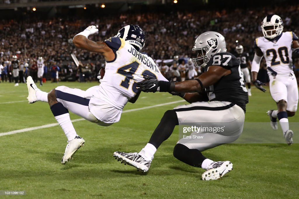 John Johnson #43 of the Los Angeles Rams intercepts a pass intended for Jared Cook #87 of the Oakland Raiders in the endzone during their NFL game at Oakland-Alameda County Coliseum on September 10, 2018 in Oakland, California.