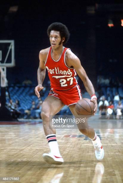 John Johnson of the Portland Trail Blazers dribbles the ball against the Washington Bullets during an NBA basketball game circa 1974 at the Capital...