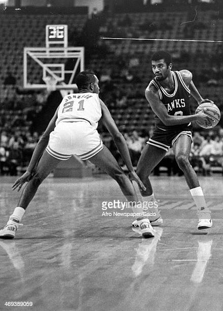 John Johnson of University of Maryland Terrapins goes head to head with Darryle Dennis of University of Maryland Hawks during a basketball game 1970