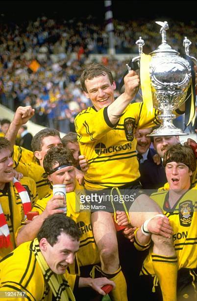 John Joyner of Castleford holds the trophy aloft after the Challenge Cup final at Wembley Stadium in London Mandatory Credit Bob Martin/Allsport