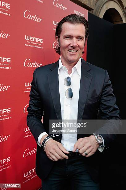 John Juergens arrives for the 'League of Gentlemen' launch of the Calibre de Cartier chronograph at Heart Club on July 11 2013 in Munich Germany
