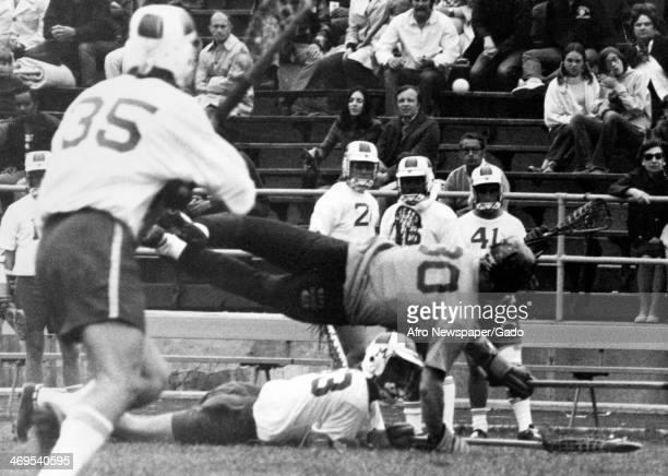 John Kaestuser who played attack for the University of Maryland and Karl Schwelm defence for Navy colliding at midfield during a lacrosse game 1970