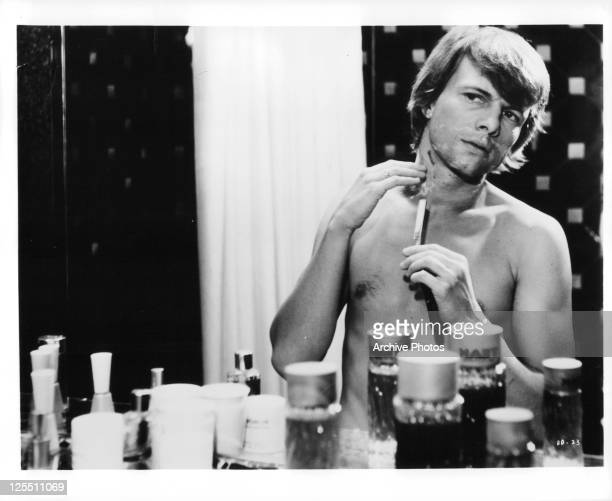 John Karlen cuts himself while shaving in a scene from the film 'Daughters Of Darkness' 1971