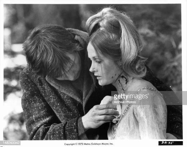 John Karlen discovers two strange bite marks on Nancy Barrett in a scene from the film 'Night Of Dark Shadows' 1971
