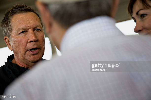 John Kasich governor of Ohio and 2016 Republican presidential candidate left speaks with Terry Branstad governor of Iowa center and Kim Reynolds...