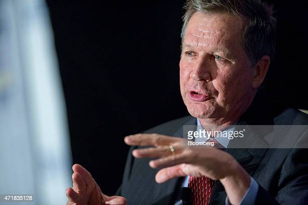 John Kasich Republican governor of Ohio speaks during a conversation at the National Review Institute 2015 Ideas Summit in Washington DC US on Friday...