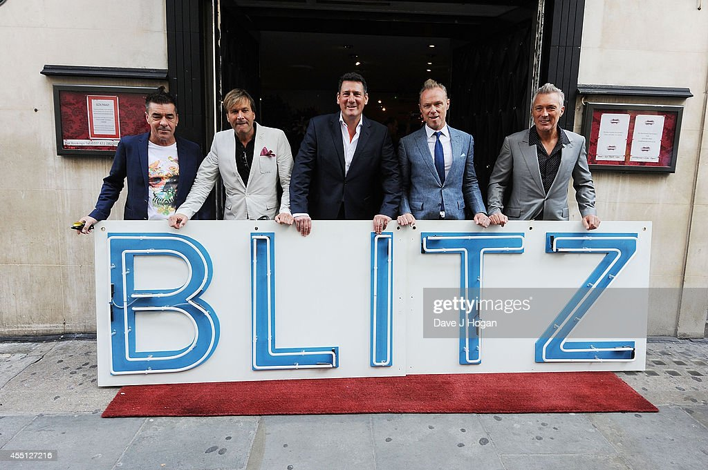 John Keeble, Steve Norman, Tony Hadley, Gary Kemp and Martin Kemp of Spandau Ballet attend a photocall as Spandau Ballet are awarded a PRS for Music Heritage award on September 10, 2014 in London, England.