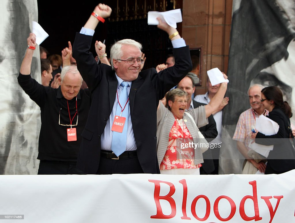 John Kelly (C), brother of Michael Kelly, celebrates after reading a copy of the long-awaited Saville Inquiry report into Bloody Sunday, outside the Guildhall in Londonderry on June 15, 2010. Publication of the report was greeted with cheers in Londonderry, Northern Ireland's second city, where relatives of those who died joined thousands waiting to see the contents of the 5,000-page report.