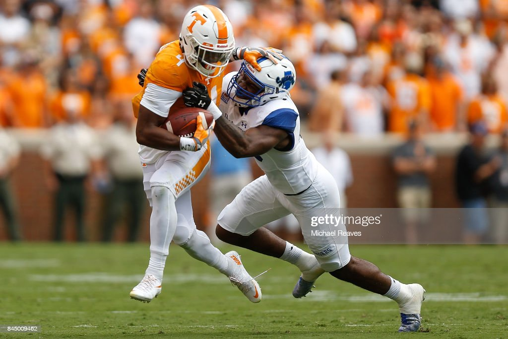 John Kelly #4 of the Tennessee Volunteers breaks a tackle from Jonas Griffith #46 of the Indiana State Sycamores during the first half of the game at Neyland Stadium on September 9, 2017 in Knoxville, Tennessee.