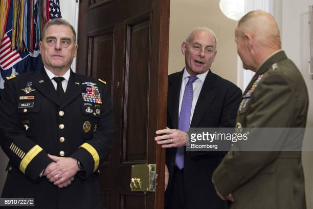 John Kelly White House chief of staff center talks to General Robert Neller commandant of the US Marine Corps right before US President Donald Trump...