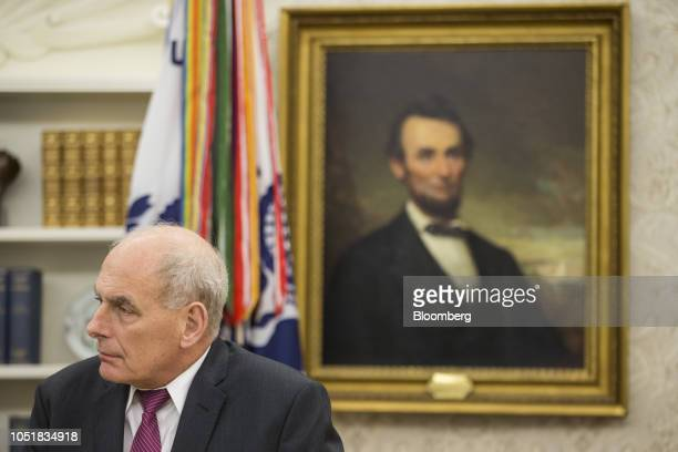 John Kelly White House chief of staff listens during a briefing on the federal response to Hurricane Michael with US President Donald Trump not...