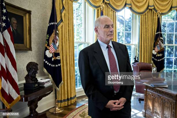 John Kelly White House chief of staff stands in the Oval Office of the White House during a meeting with US President Donald Trump and Henry...