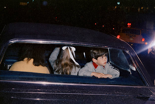 Jacqueline Kennedy Onassis, in a limousine