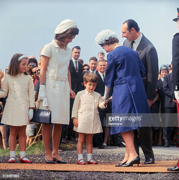 John Kennedy, Jr. Shyly bows before Queen Elizabeth at Runnymede, during inauguration of John F. Kennedy Memorial, May 14th. Looking on are Lord...