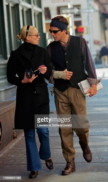 John Kennedy Jr., with his injured hand wrapped in a bandage, strolls in Tribeca with wife, Carolyn Bessette Kennedy after brunch at Bubby's. October...
